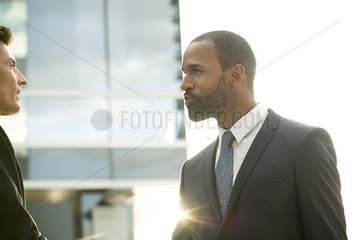 Businessmen talking together outdoors