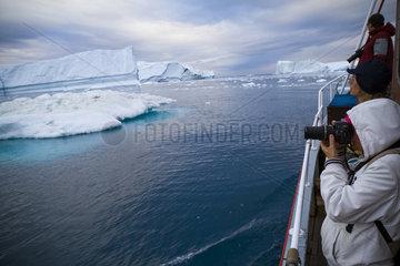 A Midnight Cruise Around The Ilulissat Ice Fjord  One Of Unesco World Heritage Sites. Greenland.