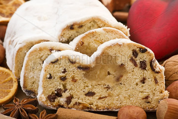 Marzipan stollen with Christmas decoration as closeup on white background