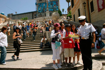 Italy. Rome - a policeman give information to young tourist