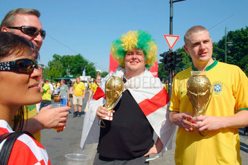 Germany. Berlin - brasilian and british football fan at a streetparty