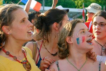 Germany. Berlin - France football fan at a streetparty