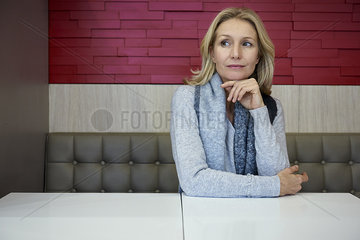 Woman sitting in cafeteria
