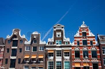 Typical Amsterdam houses over blue sky