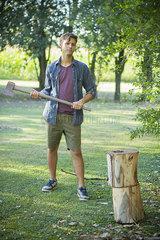 Man preparing to chop wood  portrait