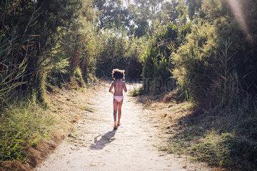 Girl walking to the beach