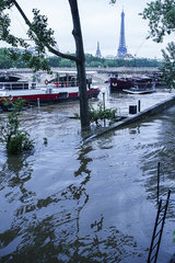 Flooded bank of the Seine River in Paris  France