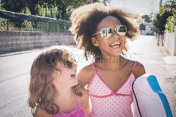 Girls laughing out loud while walking