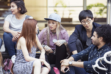 College students chatting together outdoors
