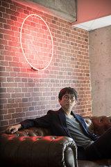 Man sitting on sofa  portrait