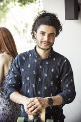 Young man holding longboard  portrait