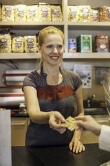 Shopkeeper accepting customer's credit card