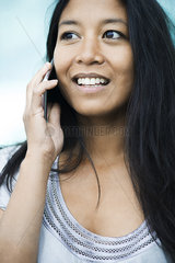 Woman talking on cell phone and smiling