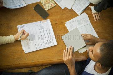 Businesswoman explaining document to client