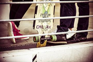 Skateboard leaning against railing