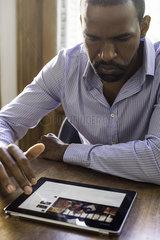 Man using digital tablet to access social media
