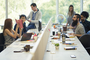 Entrepreneurs working in open plan office