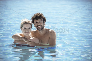 Couple relaxing together in pool  portrait