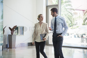 Business colleagues chatting while on the move