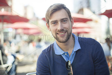 Young man smiling outdoors  portrait
