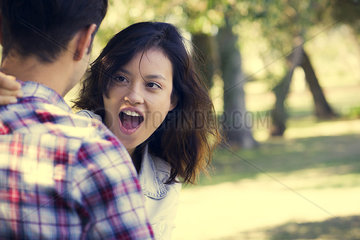 Young woman making face at boyfriend