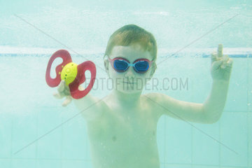 Boy playing with toy underwater