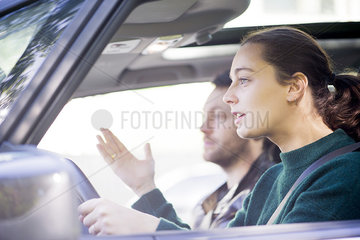 Couple chatting during road trip