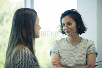 Female colleagues talking