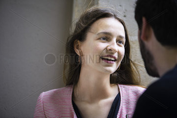 Young woman talking to man