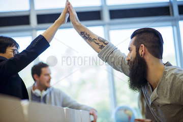 Colleagues congratulating each other