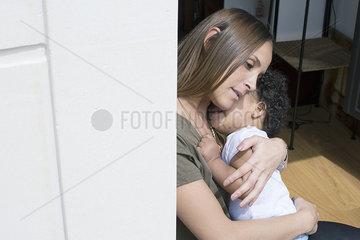 Mother comforting toddler daughter