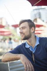 Man relaxing in outdoor cafe