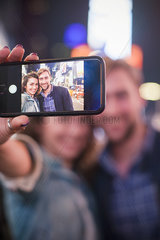 Young couple taking selfie while sightseeing in Times Square  New York City  New York  USA
