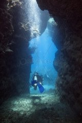 A diver when leaving a cave in Africa  Egypt  Marsa Alam  Red Sea  2010