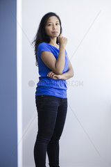 Woman standing with arms folded  portrait
