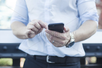 Man using smartphone  mid section