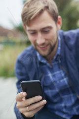Man using smartphone outdoors