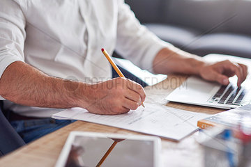 Businessman's hand filling in a contract