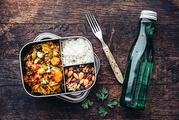 Take Away Food  tamarind vegetable stew  carrot  zucchini  bell pepper  eggplant  onion  tomato and falafel balls  rice and nuts with raisins