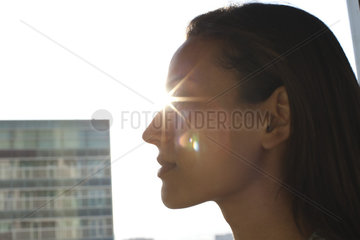 Silhouette of woman's face  sun shinning in background