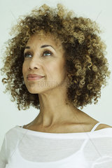 Woman looking up optimistically  portrait