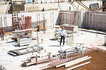 Man on cell phone on construction site