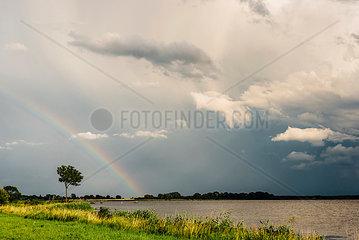 Germany  Ruegen  Middelhagen  Moenchgut  rainbow above the water