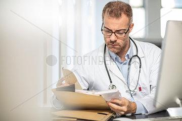 Doctor working at desk in medical practice