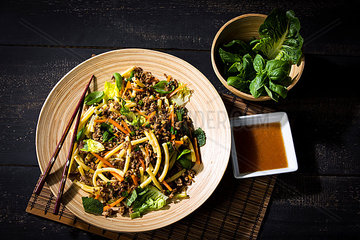 Asian mincemeat salad with macaroni  ginger  chili  garlic  carrot  spring onion  soy lemon sauce