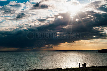 Germany  Ruegen  people at the coast and Baltic sea under cloudy sky