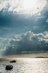Germany  Ruegen  boats floating on the sea under cloudy sky