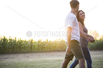 Couple taking walk together outdoors