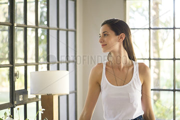 Woman enjoying view from her living room window