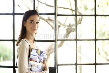 Woman using interior decorating book for inspiration